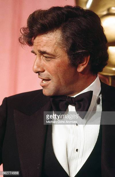 Actor Peter Falk poses backstage after presenting 'Best Costume Design' during the 46th Academy Awards at Dorothy Chandler Pavilion in Los...