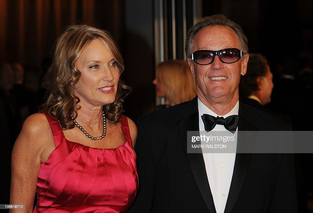Actor Peter Fonda (L) and an unidentified guest arrive on the red carpet for the 2010 Oscars Governors Awards at the Hollywood and Highland Center in Hollywood on November 13, 2010. AFP PHOTO/Mark RALSTON