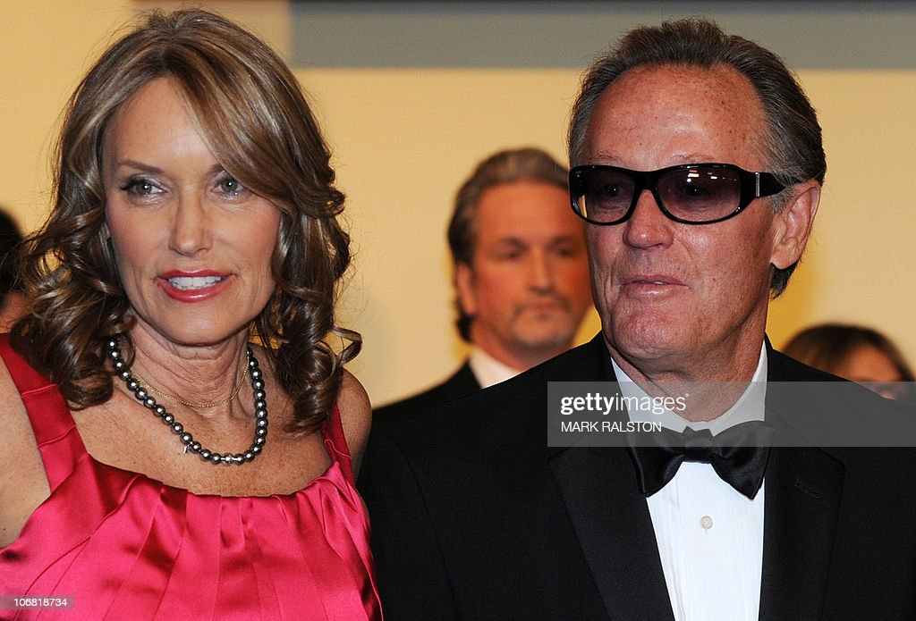 Actor Peter Fonda (R) and an unidentified guest arrive on the red carpet for the 2010 Oscars Governors Awards at the Hollywood and Highland Center in Hollywood on November 13, 2010. AFP PHOTO/Mark RALSTON