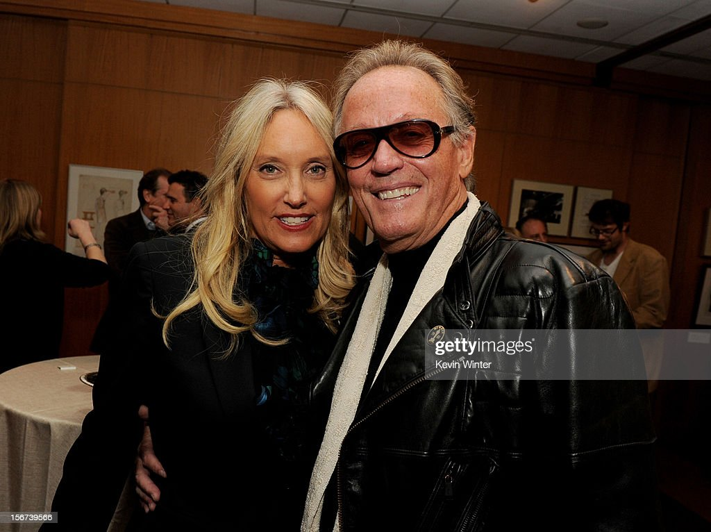 Actor <a gi-track='captionPersonalityLinkClicked' href=/galleries/search?phrase=Peter+Fonda&family=editorial&specificpeople=213498 ng-click='$event.stopPropagation()'>Peter Fonda</a> (R) and his wife Parky pose at the after party for a screening of The Weinstein Company's 'Silver Lining's Playbook' at the Academy of Motion Picture Arts and Sciences on November 19, 2012 in Beverly Hills, California.