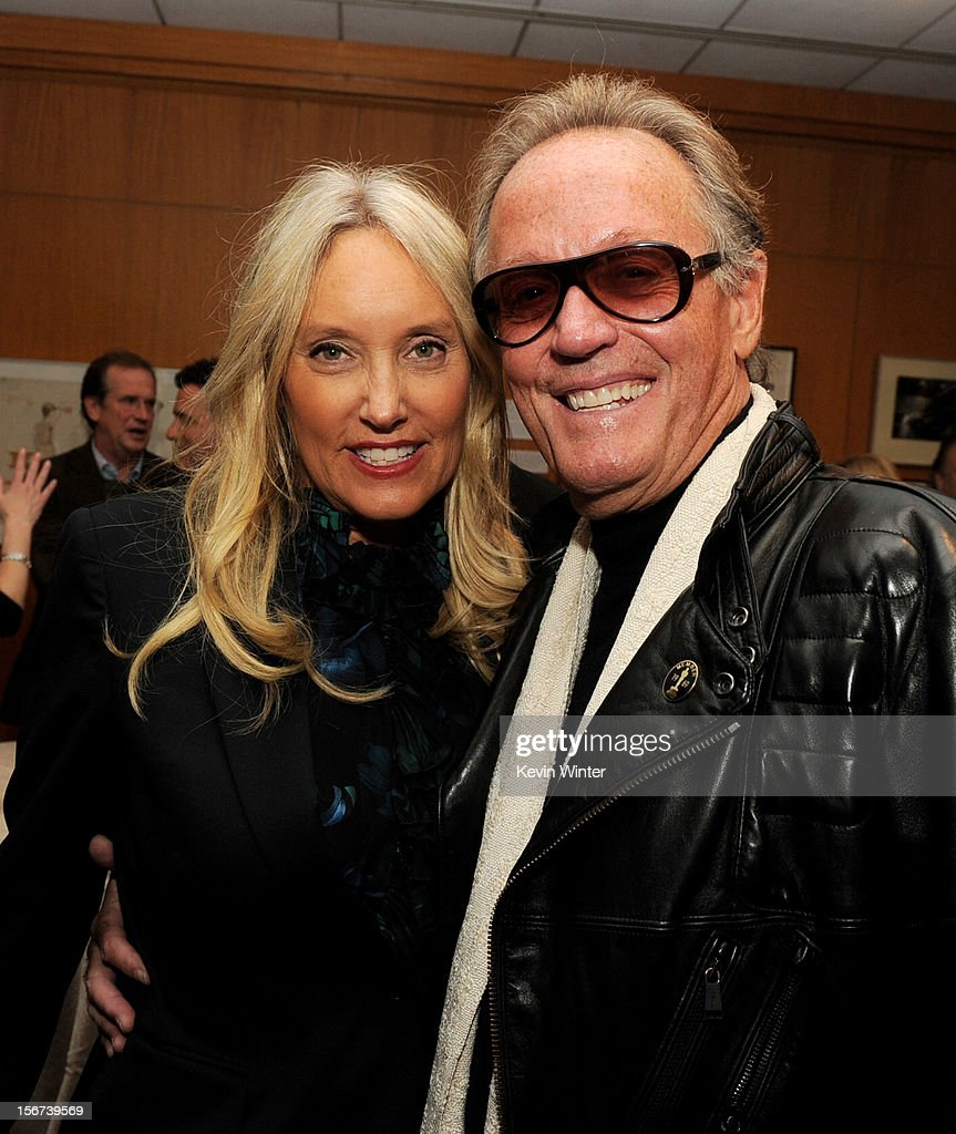 Actor Peter Fonda (R) and his wife Parky pose at the after party for a screening of The Weinstein Company's 'Silver Lining's Playbook' at the Academy of Motion Picture Arts and Sciences on November 19, 2012 in Beverly Hills, California.