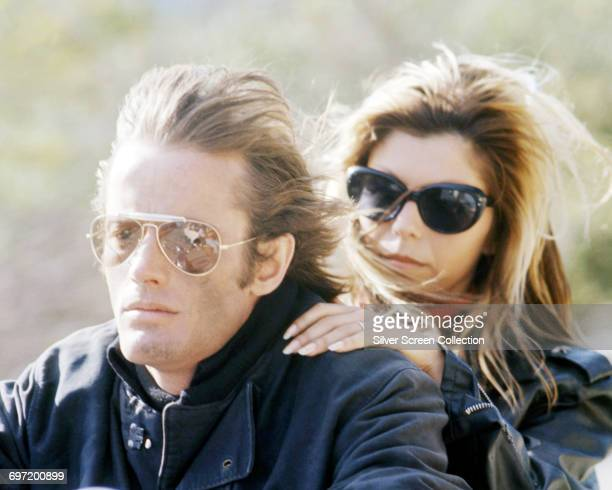 Actor Peter Fonda and singer Nancy Sinatra riding a motorcycle both wearing sunglasses in a scene from the film 'The Wild Angels' USA 1966 The Hells...