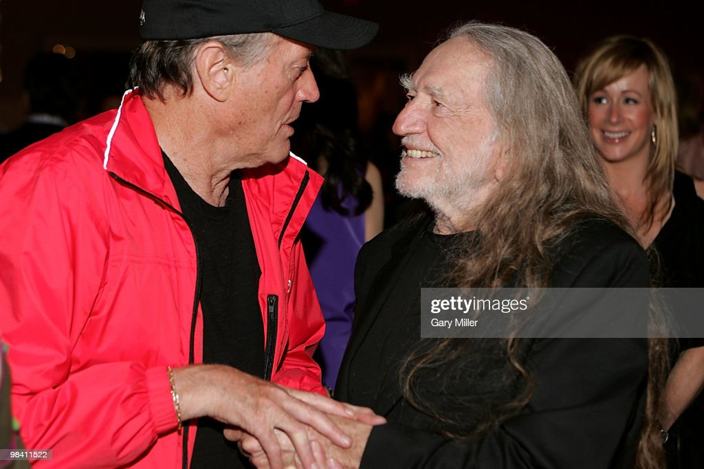 Actor Peter Fonda (L) and Willie Nelson chat at the Nobelity Project's dinner honoring Willie Nelson with the 'Feed The Peace' award at the Four Seasons Hotel on April 11, 2010 in Austin, Texas.