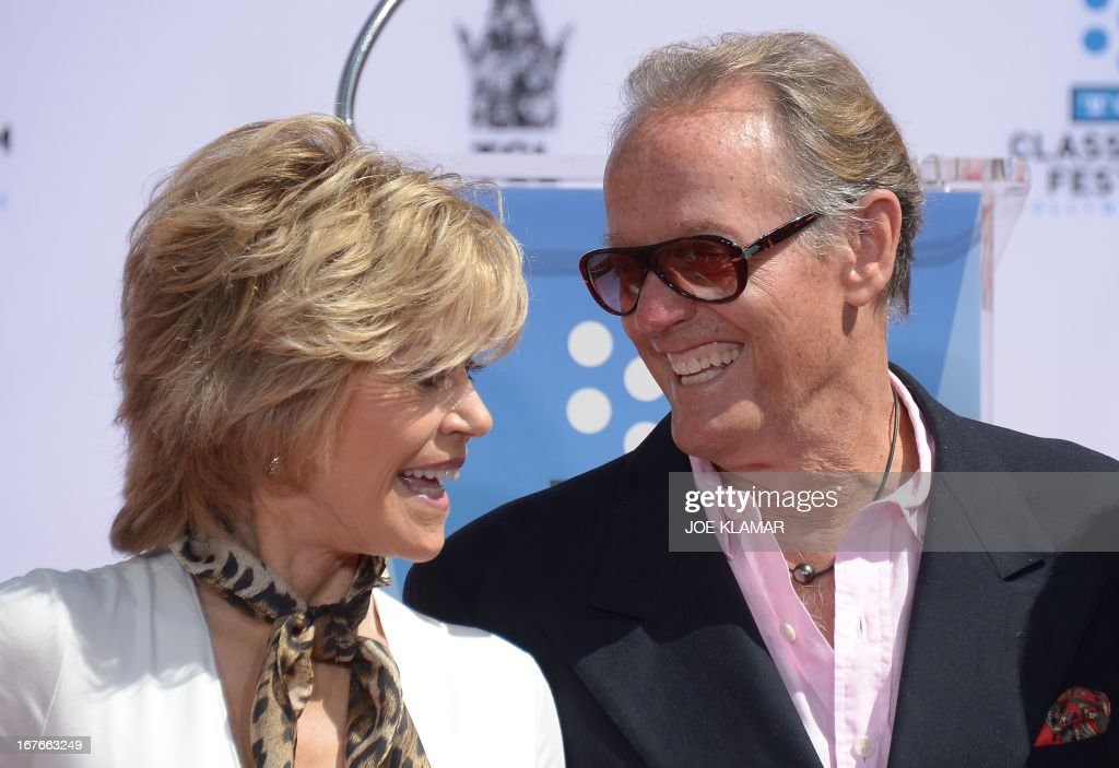 Actor Peter Fonda (L) attends his sister's Jane Fonda's (R) Handprint/Footprint Ceremony during the 2013 TCM Classic Film Festival at TCL Chinese Theatre on April 27, 2013 in Los Angeles. Fonda is an American actress, writer, political activist, former fashion model, and fitness guru. She rose to fame in the 1960s with films such as Barbarella and Cat Ballou. She has won two Academy Awards, an Emmy Award, three Golden Globes and received several other movie awards and nominations during more than 50 years as an actress. After 15 years of retirement, she returned to film in 2005 with Monster-in-Law, followed by Georgia Rule two years later. She also produced and starred in over 20 exercise videos released between 1982 and 1995, and once again in 2010. AFP PHOTO/JOE KLAMAR