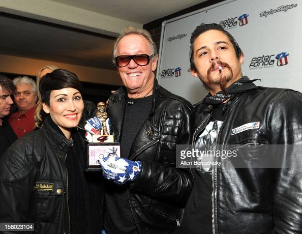 Actor Peter Fonda poses with fans at the launch of Peter Fonda's new men's fashion line and protective riding gear collection for Troy Lee Designs at...