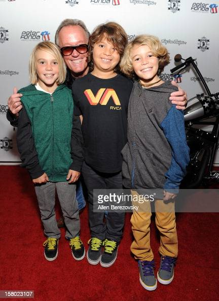 Actor Peter Fonda poses with kids at the launch of Peter Fonda's new men's fashion line and protective riding gear collection for Troy Lee Designs at...