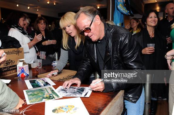 Actor Peter Fonda signs autographs at the launch of his new men's fashion line and protective riding gear collection for Troy Lee Designs at Troy Lee...