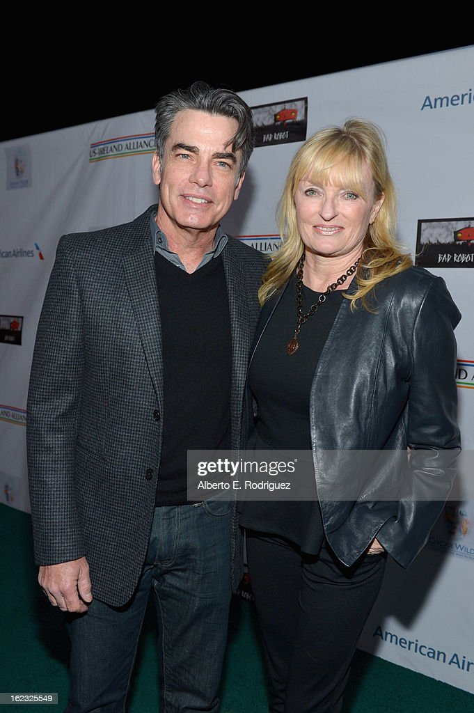 Actor <a gi-track='captionPersonalityLinkClicked' href=/galleries/search?phrase=Peter+Gallagher+-+Actor&family=editorial&specificpeople=171778 ng-click='$event.stopPropagation()'>Peter Gallagher</a> and production manager Paula Wildash attend the 8th Annual 'Oscar Wilde: Honoring The Irish In Film' Pre-Academy Awards Event at Bad Robot on February 21, 2013 in Santa Monica, California.