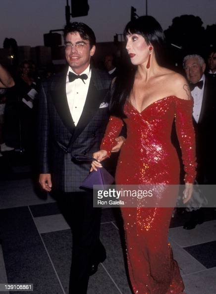 Actor Peter Gallagher and singer/actress Cher arrive for the filming of 'The Player' on July 20 1991 at the Los Angeles County Museum of Art in Los...