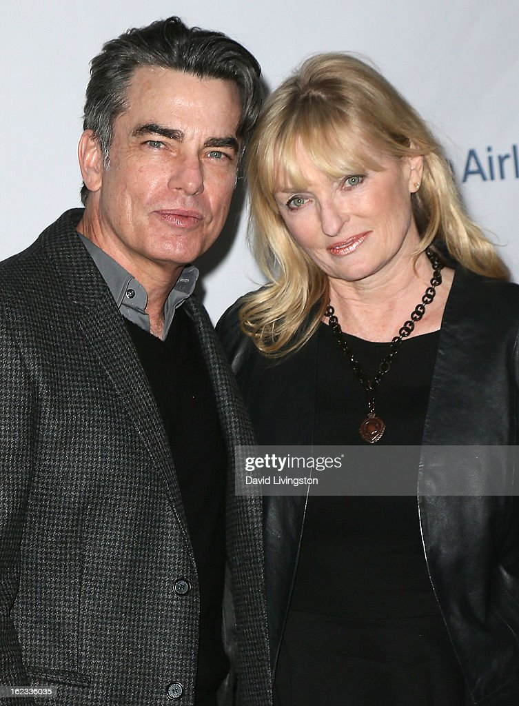 Actor Peter Gallagher (L) and wife Paula Wildash attend the 8th Annual 'Oscar Wilde: Honoring The Irish In Film' Pre-Academy Awards Event at Bad Robot on February 21, 2013 in Santa Monica, California.