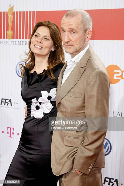 Actor Peter Lohmeyer and wife Sarah Wiener arrive at the Red Carpet for the 'Lola German Film Award 2011' at Friedrichstadtpalast on April 8 2011 in...