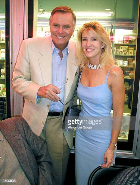 Actor Peter Marshall and wife Laurie Stewart pose as they attend a book signing for 'Backstage with the Original Hollywood Squares' at Bookstar on...