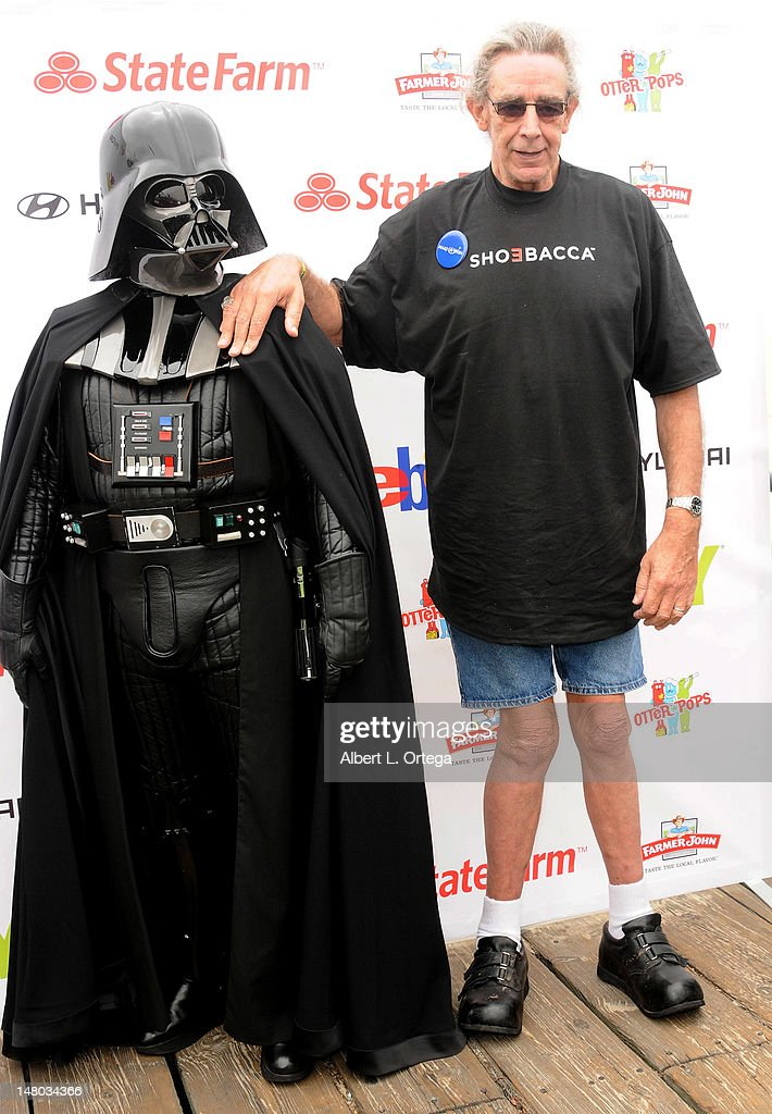 Actor Peter Mayhew and Darth Vader participate in The Inaugural 'Course Of The Force' Olympic Relay Run with lightsabers to Benefit The Make-A-Wish Foundation hosted by LucasFilm, Nerdist Industries and Octagon held at The Santa Monica Pier on July 7, 2012 in Santa Monica, California.