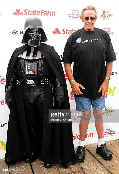 Actor Peter Mayhew and Darth Vader participate in The Inaugural 'Course Of The Force' Olympic Relay Run with lightsabers to Benefit The MakeAWish...