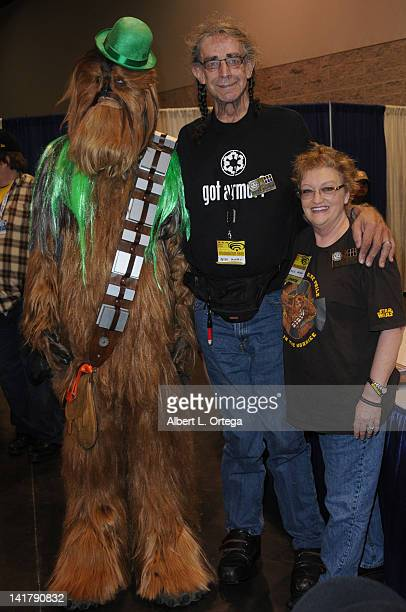 Actor Peter Mayhew and wife Angie Mayhew with Chewbacca participate in the 2012 WonderCon Day 2 held at Anaheim Convention Center on March 17 2012 in...
