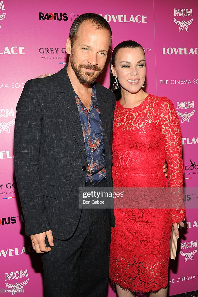 Actor Peter Sarsgaard (L) and actress Debi Mazar attend The Cinema Society and MCM with Grey Goose host a screening of Radius TWC's 'Lovelace' at The Museum of Modern Art on July 30, 2013 in New York City.