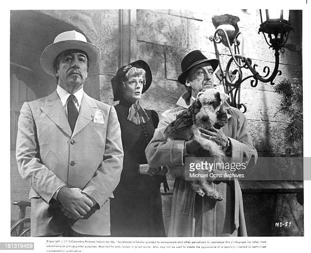 Actor Peter Sellers actress Maggie Smith and actor David Niven on the set of Columbia Pictures movie 'Murder by Death' in 1976