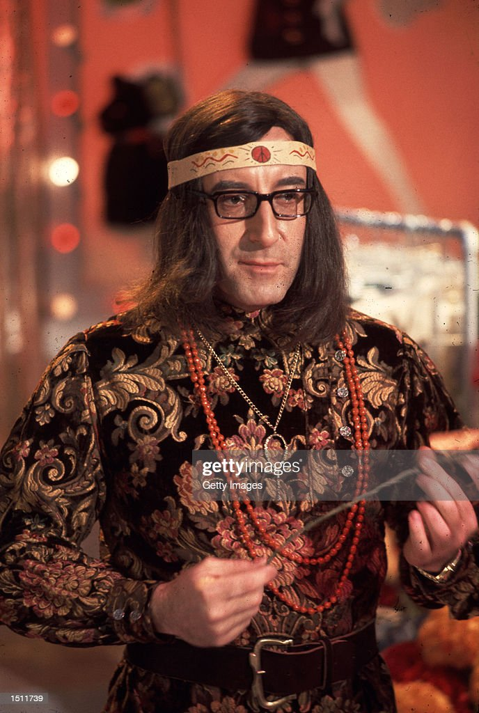 Actor Peter Sellers poses in some psychedelic clothes.