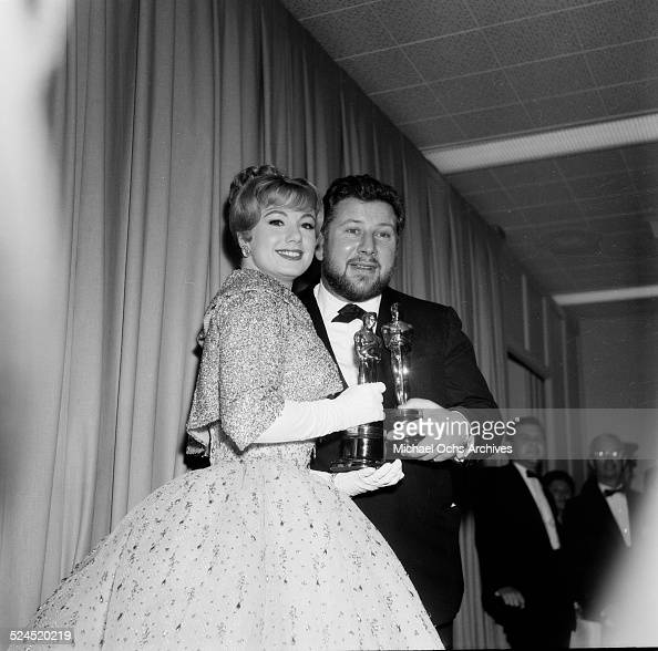 Actor Peter Ustinov poses with Shirley Jones as they hold their Oscars during the 32nd Academy Awards in Los AngelesCA