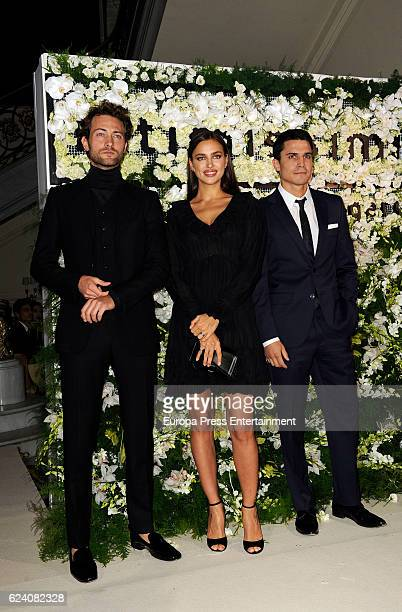 Actor Peter Vives model Irina Shayk and actor Alex Gonzalez attend Intimissimi 20 Years cocktail at Italian Embassy on November 17 2016 in Madrid...