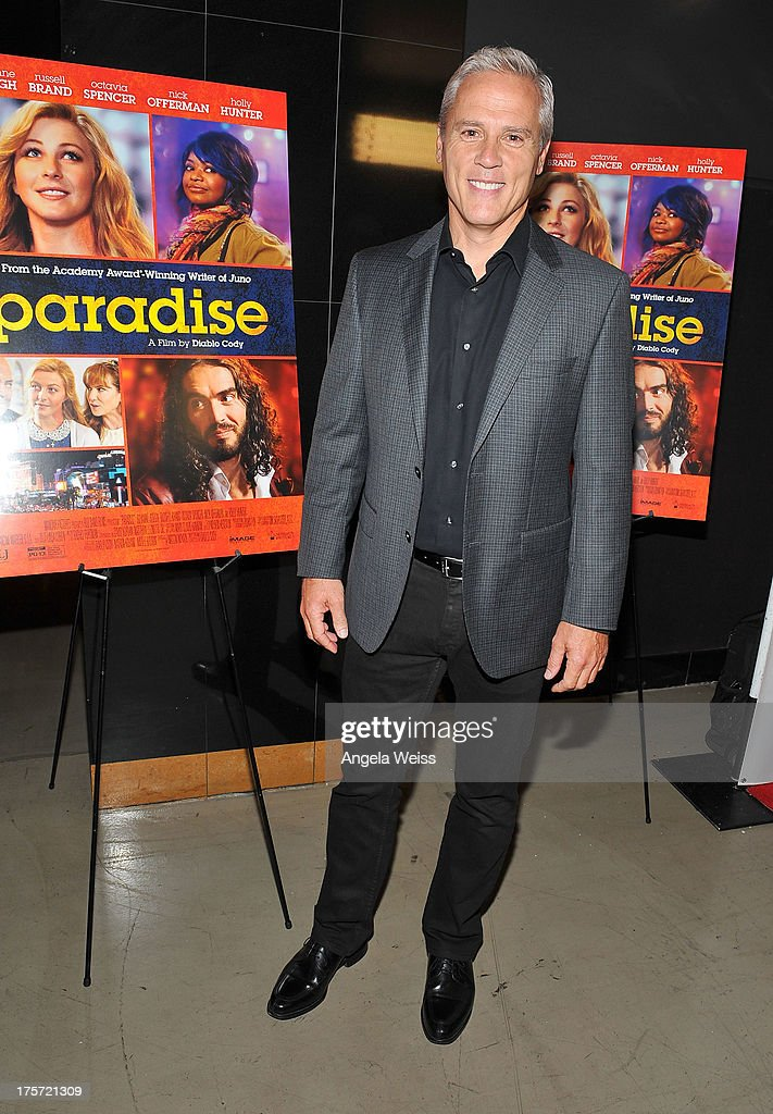 Actor Phil Austin arrives at the premiere of DirecTV's 'Paradise' at Mann Chinese 6 on August 6, 2013 in Los Angeles, California.