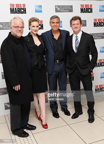 Actor Philip Seymour Hoffman actress Evan Rachel Wood filmmaker George Clooney and writer Beau Willimon attend 'The Ides of March' premiere during...