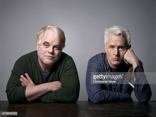 Actor Philip Seymour Hoffman and actor/director John Slattery are photographed for Entertainment Weekly Magazine on January 25 2014 in Park City Utah