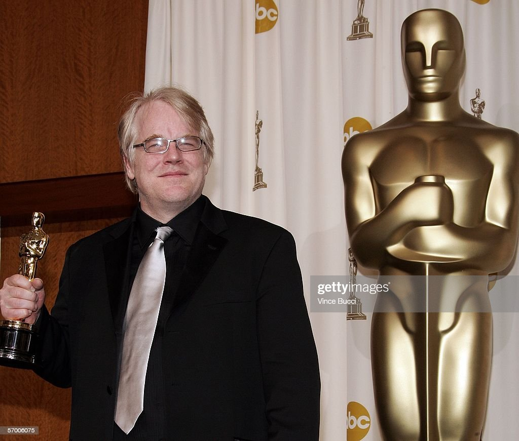 Actor Philip Seymour Hoffman poses backstage with his Oscar statuette for Best Actor in a Leading Role for the film 'Capote' during the 78th Annual...