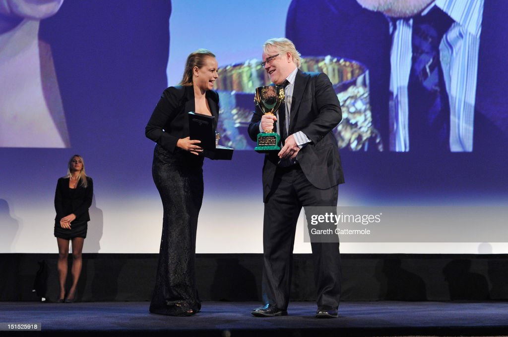 Actor <a gi-track='captionPersonalityLinkClicked' href=/galleries/search?phrase=Philip+Seymour+Hoffman&family=editorial&specificpeople=212791 ng-click='$event.stopPropagation()'>Philip Seymour Hoffman</a> wins the Coppa Volpi award for best actor on stage during the Award Ceremony at the 69th Venice Film Festival at the Palazzo del Cinema on September 8, 2012 in Venice, Italy.