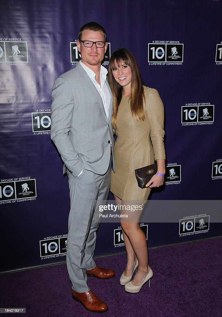 Actor Philip Winchester (L) and his wife Megan Marie Coughlin (R) attend the Wounded Warrior Project's 'Carry Forward Awards' at Club Nokia on October 10, 2013 in Los Angeles, California.