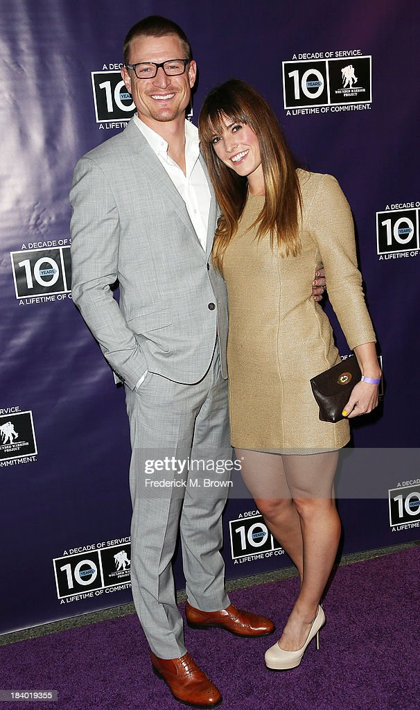 Actor Philip Winchester (L) and Megan Marie Coughlin attend The Wounded Warrier Project's (WWP) Carry Forward Awards at Club Nokia on October 10, 2013 in Los Angeles, California.