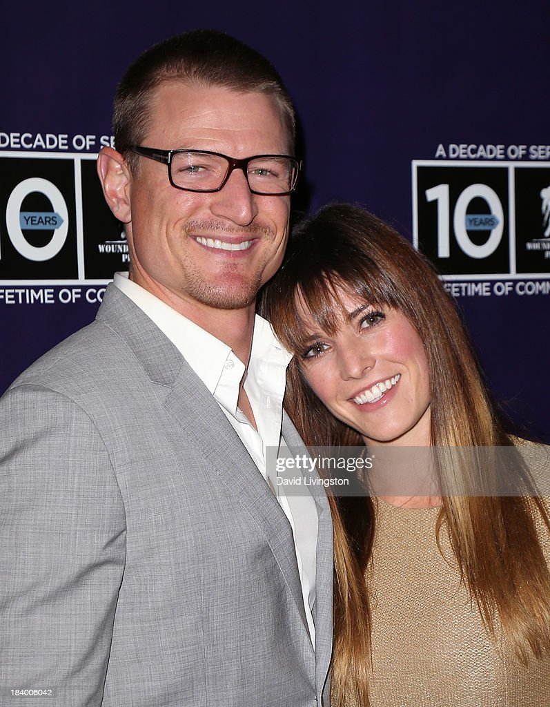 Actor Philip Winchester (L) and wife Megan Marie Coughlin attend the Wounded Warrior Project's (WWP) Carry Forward Awards at Club Nokia on October 10, 2013 in Los Angeles, California.
