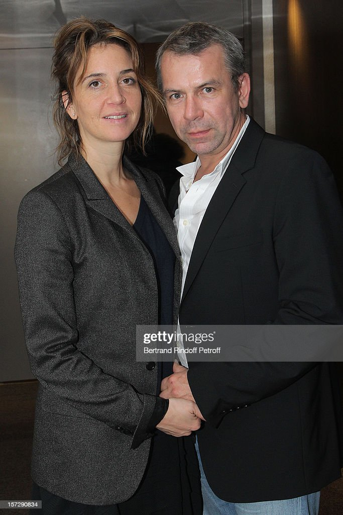 Actor Philippe Torreton (R) and his wife Elsa Boublil pose in French impersonator Laurent Gerra's dressing room prior to Gerra's One Man Show at Palais des Congres on November 29, 2012 in Paris, France.