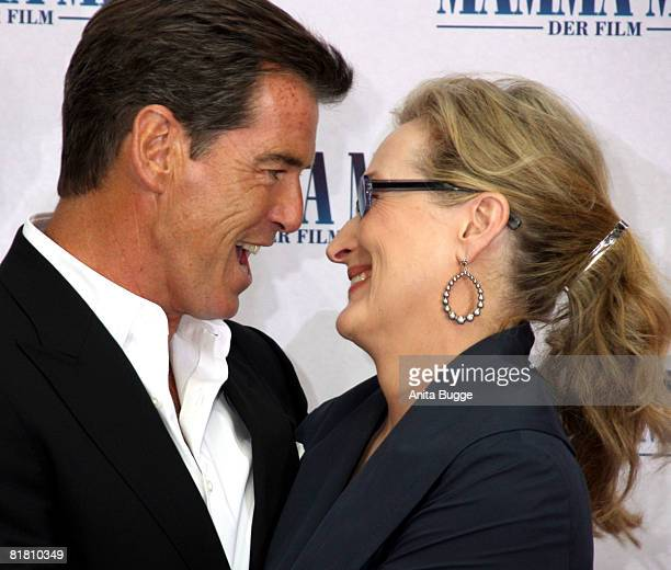 Actor Pierce Brosnan and actress Meryl Streep attend the photocall for 'Mamma Mia The Movie' at the Adlon Hotel on July 3 2008 in Berlin Germany