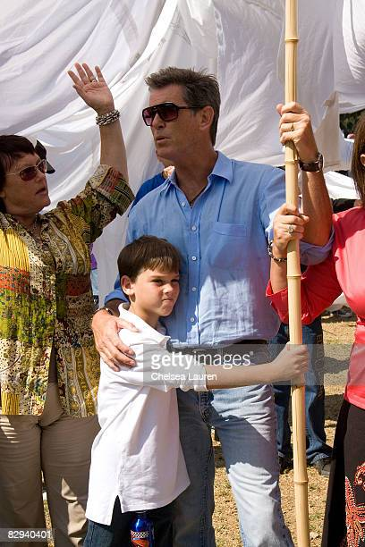 Actor Pierce Brosnan and his son Paris prepare to join a procession carrying giant banners representing doves of peace during Roots Shoots Day of...