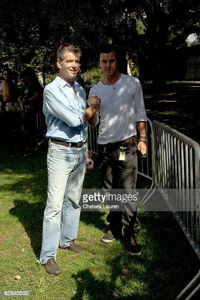Actor Pierce Brosnan and musician Gavin Rossdale greet each other during Roots Shoots Day of Peace at Griffith Park on September 21 2008 in Los...