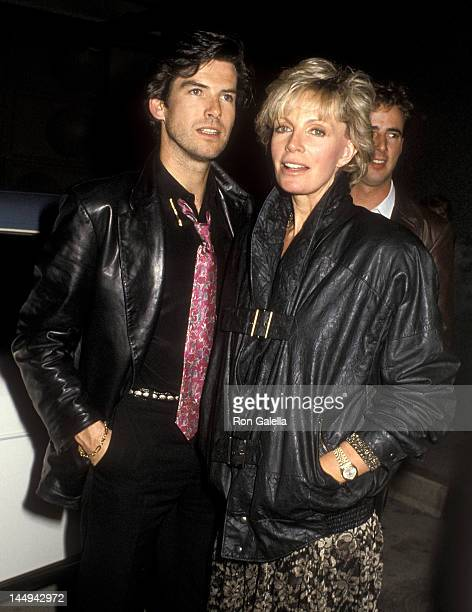 Actor Pierce Brosnan and wife Cassandra Harris on March 1 1986 dine at Tramps Restaurant in West Hollywood California