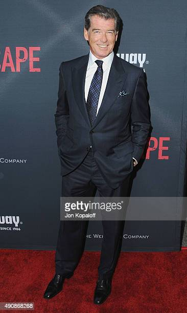 Actor Pierce Brosnan arrives at the Los Angeles Premiere 'No Escape' at Regal Cinemas LA Live on August 17 2015 in Los Angeles California