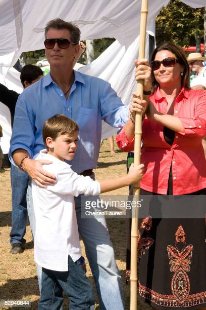 Actor Pierce Brosnan his wife Keeley Shaye Smith and their son Paris prepare to join a procession carrying giant banners representing doves of peace...