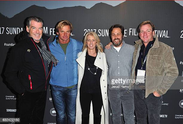 Actor Pierce Brosnan Laird Hamilton Director Rory Kennedy Writer Mark Bailey and Producer Paul Speaker attend the 'TAKE EVERY WAVE The Life Of Laird...