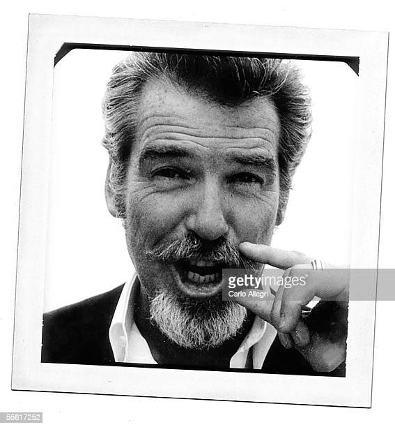 Actor Pierce Brosnan poses for a polaroid portrait while promoting the film 'Matador' at the Toronto International Film Festival September 15 2005 in...