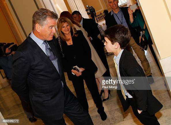 Actor Pierce Brosnan talks with a young fan at The American Cancer Society Cancer Action Network and Stand Up To Cancer discussion on the importance...