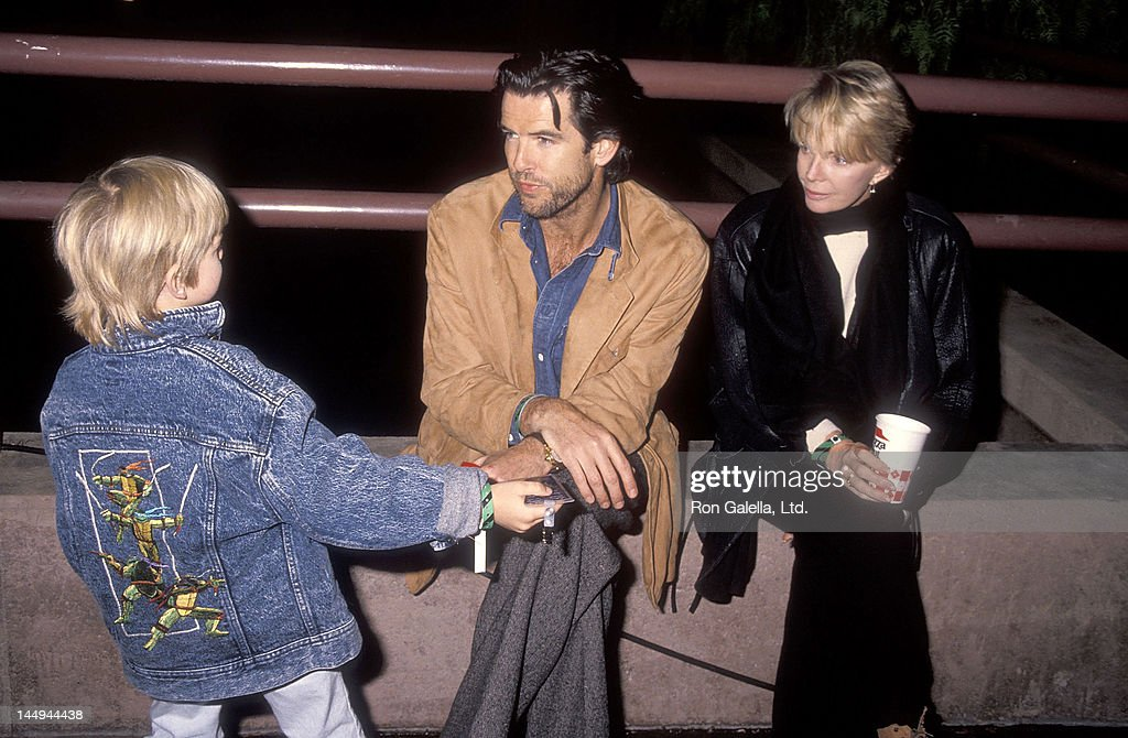 Actor Pierce Brosnan, wife Cassandra Harris and son Sean Brosnan attend the Pre-Show Backstage Pizza Party for the Teenage Mutant Ninja Turtle's 'Coming Out of Their Shells' Rock & Roll Tour on November 21, 1990 at the Universal Amphitheatre in Universal City, California.
