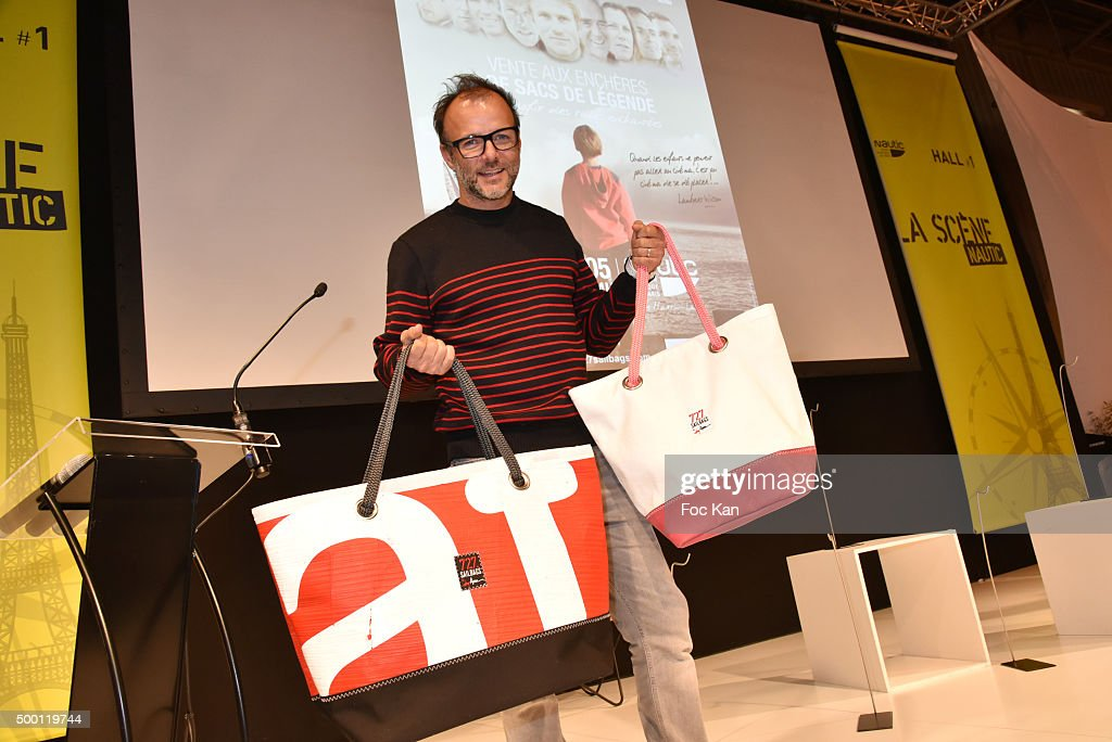 Actor Pierre Franois Martin Laval aka Pef presents bags tailored in sails during the '727 Sailbags' Auction in Benefit to 'Les Toiles Enchantees'...