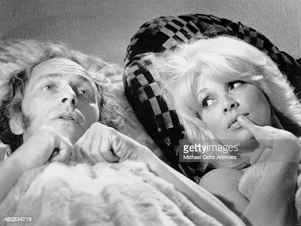 Actor Pierre Richard and actress Mireille Darc in a scene from the French movie 'The Tall Blond Man with One Black Shoe' circa 1972