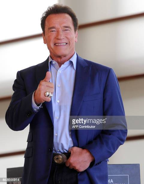 TOPSHOT US actor producer and former governor of California Arnold Schwarzenegger poses during a photocall to promote the film 'Wonders of the Sea...