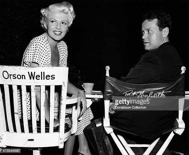 Actor producer writer and director Orson Welles poses with actress and wife Rita Hayworth on the set of the Columbia Pictures film 'The Lady from...