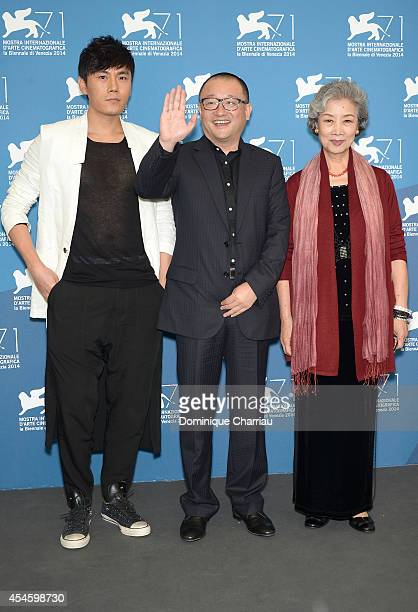 Actor Qin Hao director Wang Xiaoshuai and actress Lu Zhong attend the 'Red Amnesia' photocall during the 71st Venice Film Festival at Palazzo del...