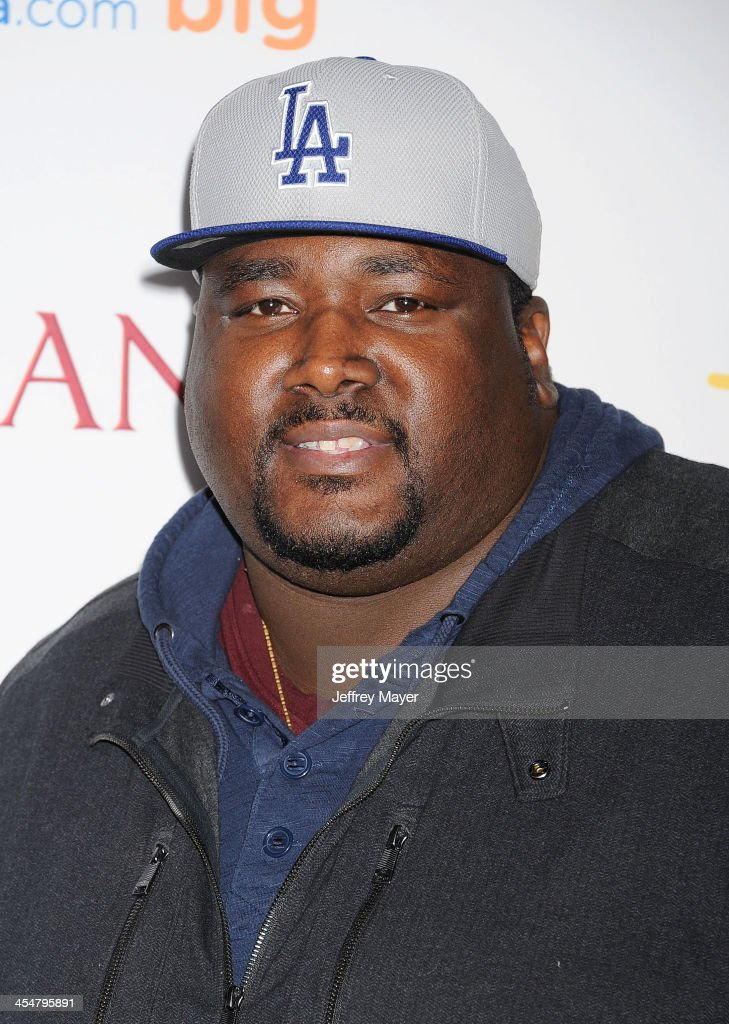Actor <a gi-track='captionPersonalityLinkClicked' href=/galleries/search?phrase=Quinton+Aaron&family=editorial&specificpeople=6527390 ng-click='$event.stopPropagation()'>Quinton Aaron</a> arrives at the 'Saving Mr. Banks' - Los Angeles Premiere at Walt Disney Studios on December 9, 2013 in Burbank, California.
