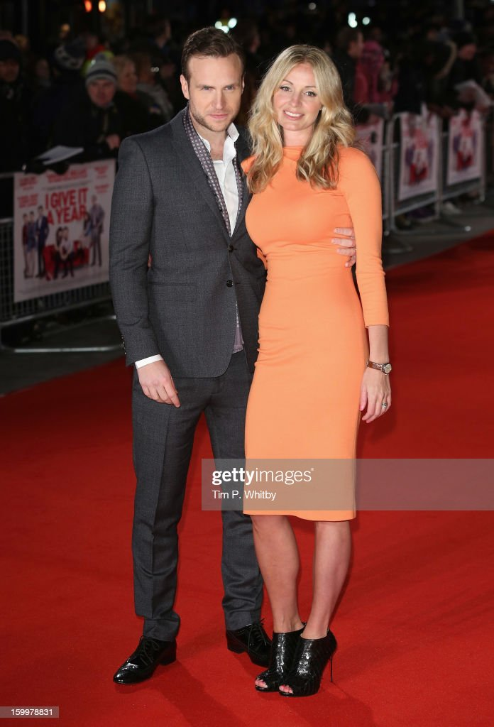Actor Rafe Spall with his wife <a gi-track='captionPersonalityLinkClicked' href=/galleries/search?phrase=Elize+Du+Toit&family=editorial&specificpeople=210544 ng-click='$event.stopPropagation()'>Elize Du Toit</a> attend the UK Premiere of 'I Give It A Year' at the Vue West End on January 24, 2013 in London, England.